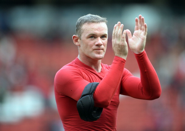 MANCHESTER, ENGLAND - SEPTEMBER 14:  Wayne Rooney of Manchester United applauds the crowd after the Barclays Premier League match between Manchester United and Crystal Palace at Old Trafford on September 14, 2013 in Manchester, England.  (Photo by Michael Regan/Getty Images)