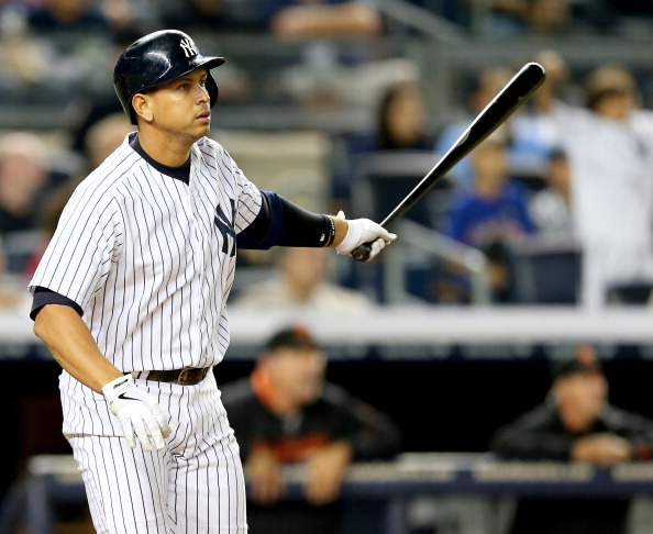 NEW YORK, NY - SEPTEMBER 20:  Alex Rodriguez #13 of the New York Yankees watches his hit fly out of the park and turn into a grand slam in the seventh inning against the San Francisco Giants during interleague  play on September 20, 2013 at Yankee Stadium in the Bronx borough of New York City.  (Photo by Elsa/Getty Images)