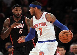 Jan 9, 2014; New York, NY, USA; New York Knicks small forward Carmelo Anthony (7) controls the ball against Miami Heat small forward LeBron James (6) during the first quarter of a game at Madison Square Garden. Mandatory Credit: Brad Penner-USA TODAY Sports