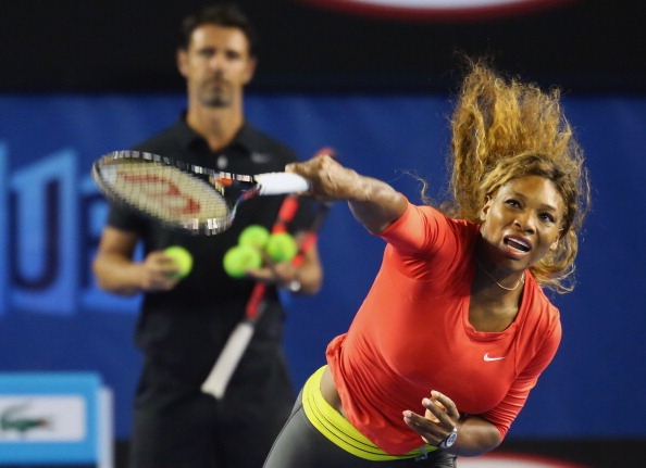 MELBOURNE, AUSTRALIA - JANUARY 06:  Serena Williams of the USA serves as her coach Patrick Mouratoglou looks on during a practice session ahead of the 2014 Australian Open at Melbourne Park on January 6, 2014 in Melbourne, Australia.  (Photo by Scott Barbour/Getty Images)