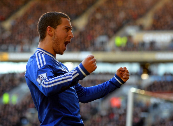 HULL, ENGLAND - JANUARY 11: Eden Hazard of Chelsea celebrates scoring their first goal during the Barclays Premier League match between Hull City and Chelsea at KC Stadium on January 11, 2014 in Hull, England.  (Photo by Laurence Griffiths/Getty Images)