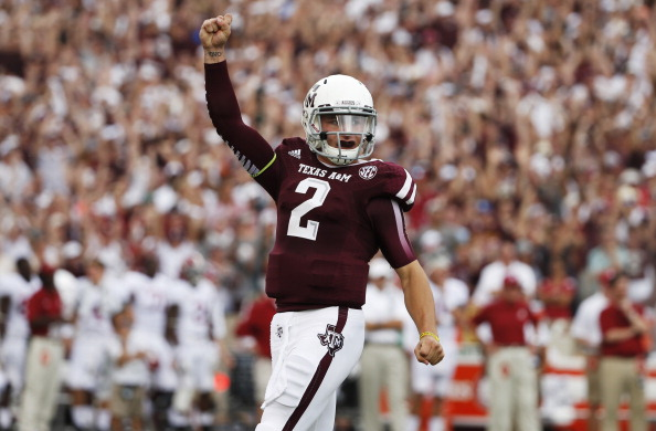 COLLEGE STATION, TX - SEPTEMBER 14:  Johnny Manziel #2 of the Texas A&M Aggies celebrates after throwing a first quarter touchdown during a game against the Alabama Crimson Tide at Kyle Field on September 14, 2013 in College Station, Texas.  (Photo by Scott Halleran/Getty Images)