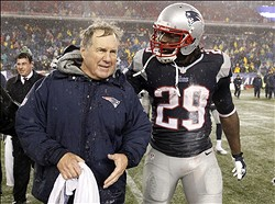 Dec 29, 2013; Foxborough, MA, USA; New England Patriots head coach Bill Belichick and running back LeGarrette Blount (29) after the game against the Buffalo Bills at Gillette Stadium. The Patriots defeated the Bills 34-20.0 Mandatory Credit: David Butler II-USA TODAY Sports