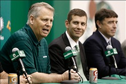Jul 5, 2013; Waltham, MA, USA; General Manager Danny Ainge talks about hiring new Boston Celtics head coach Brad Stevens, center, as owner Wyc Grousbeck, right, listens in during a news conference announcing Stevens new position. Mandatory Credit: Winslow Townson-USA TODAY Sports