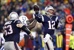 Jan 11, 2014; Foxborough, MA, USA; New England Patriots quarterback Tom Brady (12) throws a pass against the Indianapolis Colts in the second half during the 2013 AFC divisional playoff football game at Gillette Stadium. Mandatory Credit: Mark L. Baer-USA TODAY Sports