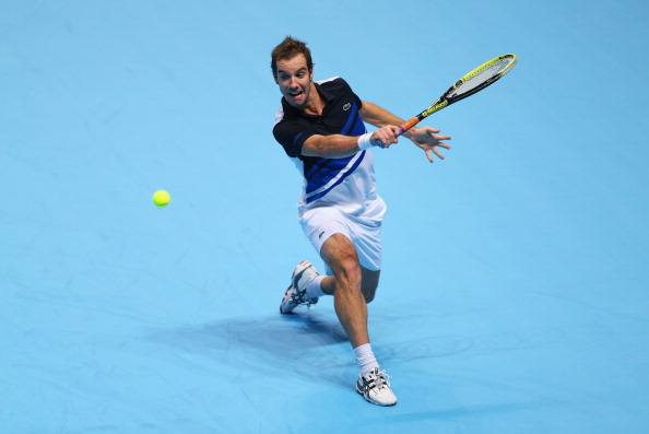 LONDON, ENGLAND - NOVEMBER 07:  Richard Gasquet of France hits a backhand during his men's singles match against Roger Federer of Switzerland  during day four of the Barclays ATP World Tour Finals at O2 Arena on November 7, 2013 in London, England.  (Photo by Clive Brunskill/Getty Images)