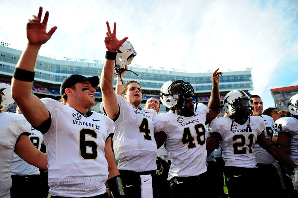 GAINESVILLE, FL - NOVEMBER 09:  Austin Carta-Samuels #6, Patton Robinette #4, Nigel Bowden #48 and Paris Head #21 of the Vanderbilt Commodores celebrate a victory over the Florida Gators following a game at Ben Hill Griffin Stadium on November 9, 2013 in Gainesville, Florida. Vanderbilt won the game 34-17.  (Photo by Stacy Revere/Getty Images)