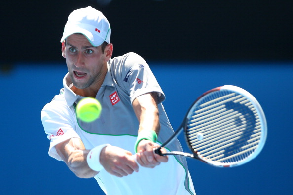 MELBOURNE, AUSTRALIA - JANUARY 15:  Novak Djokovic of Serbia plays a backhand in his second round match against Leonardo Mayer of Argentina during day three of the 2014 Australian Open at Melbourne Park on January 15, 2014 in Melbourne, Australia.  (Photo by Chris Hyde/Getty Images)