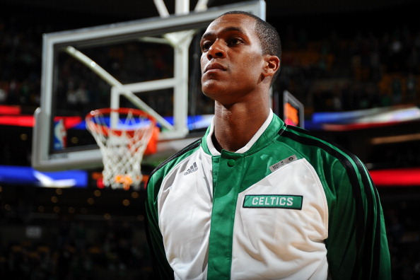 BOSTON, MA - JANUARY 15: Rajon Rondo #9 of the Boston Celtics during the national anthem before the game against the Toronto Raptors on January 15, 2014 at the TD Garden in Boston, Massachusetts.  NOTE TO USER: User expressly acknowledges and agrees that, by downloading and or using this photograph, User is consenting to the terms and conditions of the Getty Images License Agreement. Mandatory Copyright Notice: Copyright 2014 NBAE  (Photo by Brian Babineau/NBAE via Getty Images)