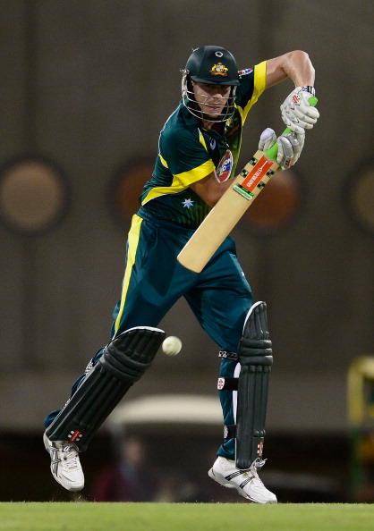 BRISBANE, AUSTRALIA - JANUARY 17:  James Faulkner of Australia bats during the second game of the One Day International Series between Australia and England at The Gabba on January 17, 2014 in Brisbane, Australia.  (Photo by Ian Hitchcock/Getty Images)