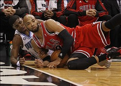 Jan 15, 2014; Orlando, FL, USA; Chicago Bulls power forward Taj Gibson (22) battles for the ball with Orlando Magic point guard E'Twaun Moore (55) during the second quarter at Amway Center. Mandatory Credit: Kim Klement-USA TODAY Sports