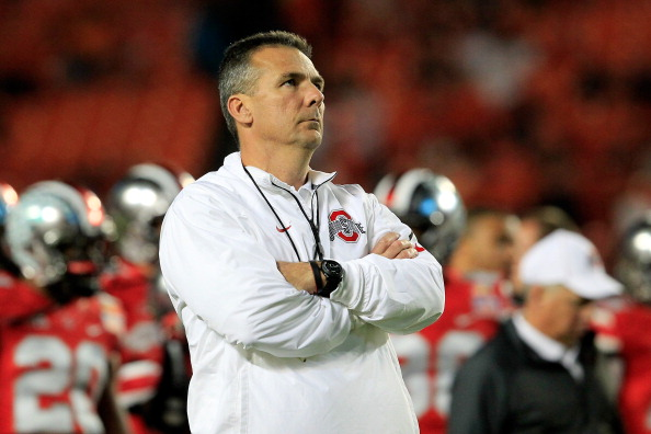 MIAMI GARDENS, FL - JANUARY 03:  Head coach Urban Meyer of the Ohio State Buckeyes looks on during warm ups prior to the Discover Orange Bowl against the Clemson Tigers at Sun Life Stadium on January 3, 2014 in Miami Gardens, Florida.  (Photo by Chris Trotman/Getty Images)