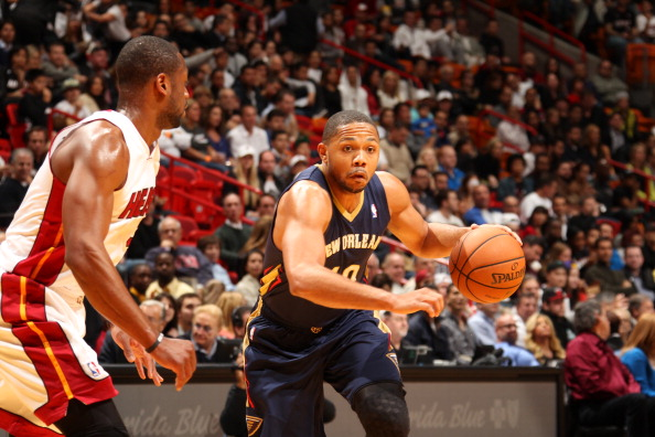 MIAMI, FL - JANUARY 7: Eric Gordon #10 of the New Orleans Pelicans goes up for the layup against the Miami Heat at the American Airlines Arena in Miami, Florida on Jan. 7, 2014. NOTE TO USER: User expressly acknowledges and agrees that, by downloading and/or using this photograph, user is consenting to the terms and conditions of the Getty Images License Agreement. Mandatory copyright notice: Copyright NBAE 2014 (Photo by Issac Baldizon/NBAE via Getty Images)