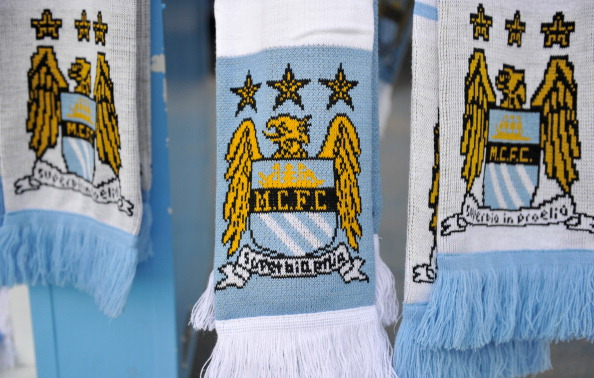 MANCHESTER, ENGLAND - DECEMBER 28:  Detail of Manchester City scarves on a merchandise stall prior to the Barclays Premier League match between Manchester City and Crystal Palace at the Etihad Stadium on December 28, 2013 in Manchester, England.  (Photo by Clint Hughes/Getty Images)
