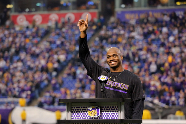 MINNEAPOLIS, MN - DECEMBER 29:  Adrian Peterson #28 of the Minnesota Vikings speaks to the crowd after the last game at the Metrodome against the Detroit Lions on December 29, 2013 at Mall of America Field at the Hubert H. Humphrey Metrodome in Minneapolis, Minnesota. (Photo by Adam Bettcher/Getty Images)