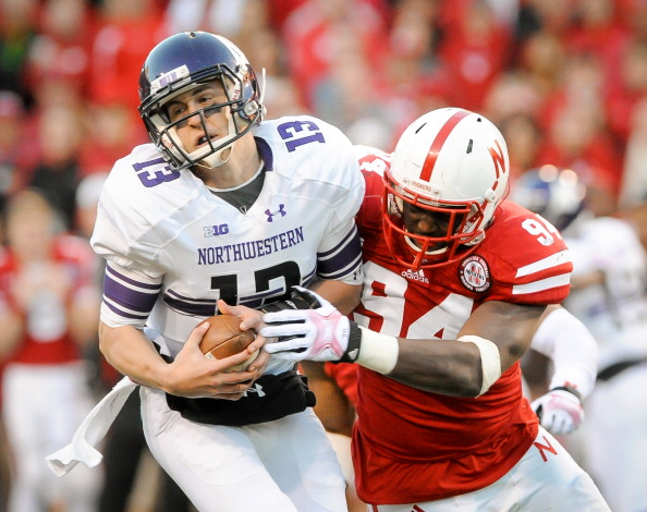 LINCOLN, NE - NOVEMBER 2: Defensive end Avery Moss #94 of the Nebraska Cornhuskers sacks quarterback Trevor Siemian #13 of the Northwestern Wildcats during their game at Memorial Stadium on November 2, 2013 in Lincoln, Nebraska. (Photo by Eric Francis/Getty Images)