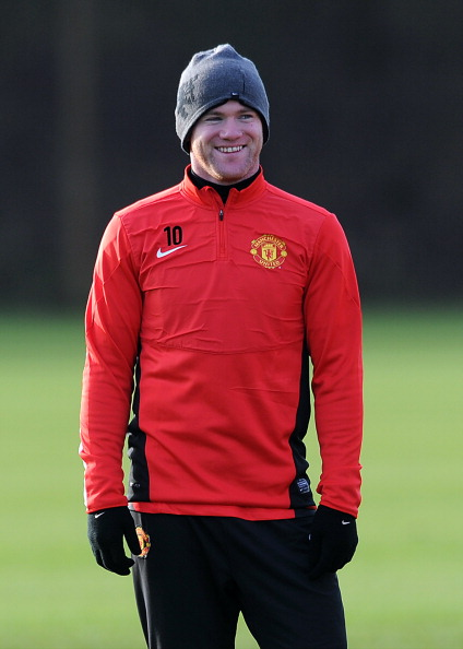 MANCHESTER, ENGLAND - DECEMBER 09: Wayne Rooney of Manchester United looks on during a first team training session, ahead of their UEFA Champions League Group A match against Shakhtar Donetsk, at Aon Training Complex on December 09, 2013 in Manchester, England. (Photo by Chris Brunskill/Getty Images)