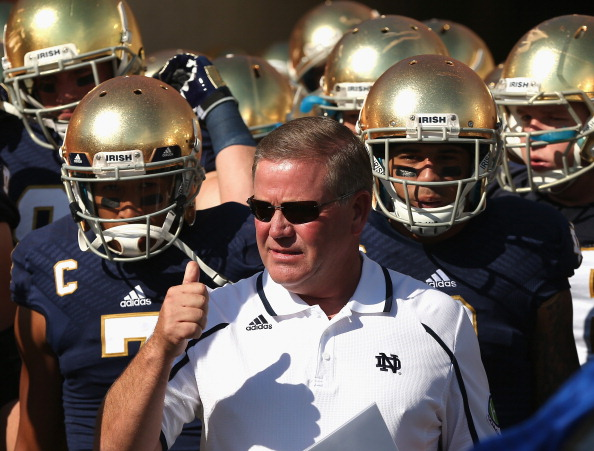 SOUTH BEND, IN - SEPTEMBER 28:  Head coach Brian Kelly of the Notre Dame Fighting Irish waits torun onto the field with his team before a game against the Oklahoma Sooners at Notre Dame Stadium on September 28, 2013 in South Bend, Indiana. Oklahoma defeated Notre Dame 35-21.  (Photo by Jonathan Daniel/Getty Images)