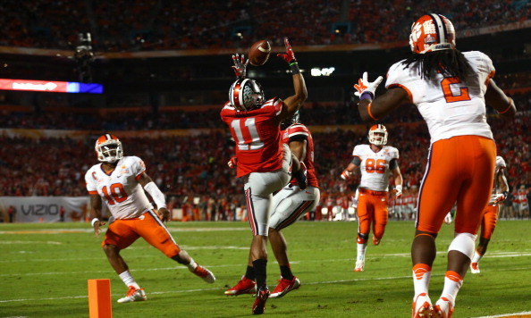 MIAMI GARDENS, FL - JANUARY 03:  Vonn Bell #11 of the Ohio State Buckeyes intercepts a pass thrown by Tajh Boyd #10 of the Clemson Tigers in the second quarter during the Discover Orange Bowl at Sun Life Stadium on January 3, 2014 in Miami Gardens, Florida.  (Photo by Streeter Lecka/Getty Images)