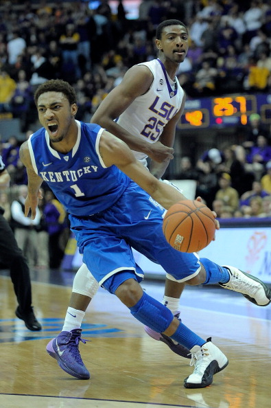 BATON ROUGE, LA - JANUARY 28:  James Young #1 of the Kentucky Wildcats is fouled by Jordan Mickey #25 of the LSU Tigers during a game at the Pete Maravich Assembly Center on January 28, 2014 in Baton Rouge, Louisiana.  LSU won the game 87-82.  (Photo by Stacy Revere/Getty Images)