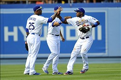September 1, 2013; Los Angeles, CA, USA; Los Angeles Dodgers right fielder Yasiel Puig (66), left fielder Carl Crawford (25) and center fielder Andre Ethier (16) celebrate the 2-1 victory against the San Diego Padres at Dodger Stadium. Mandatory Credit: Gary A. Vasquez-USA TODAY Sports