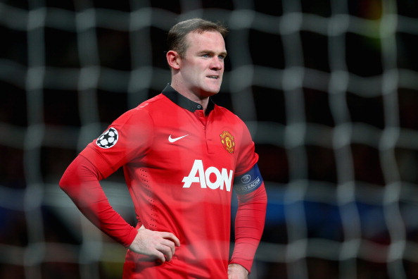 MANCHESTER, ENGLAND - DECEMBER 10:  Wayne Rooney of Manchester United looks on during the UEFA Champions League Group A match between Manchester United and Shakhtar Donetsk at Old Trafford on December 10, 2013 in Manchester, England.  (Photo by Michael Steele/Getty Images)