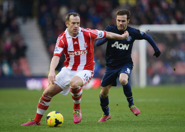STOKE ON TRENT, ENGLAND - FEBRUARY 01:  Charlie Adam of Stoke City is closed down by Juan Mata of Manchester United during the Barclays Premier League match between Stoke City and Manchester United at Britannia Stadium on February 1, 2014 in Stoke on Trent, England.  (Photo by Jamie McDonald/Getty Images)