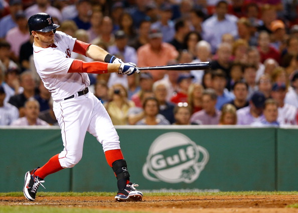 BOSTON, MA - SEPTEMBER 4: Will Middlebrooks #16 of the Boston Red Sox hits a grand slam home run in the 6th inning off of Al Alburquerque #62 of the Detroit Tigers during the game on September 4, 2013 at Fenway Park in Boston, Massachusetts. (Photo by Jared Wickerham/Getty Images)