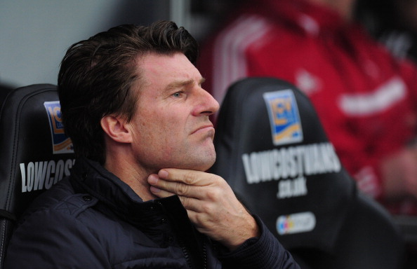 SWANSEA, WALES - JANUARY 01:  Swansea City manager Michael Laudrup looks on before the Barclays Premier League match between Swansea City and Manchester City at Liberty Stadium on January 1, 2014 in Swansea, Wales.  (Photo by Stu Forster/Getty Images)