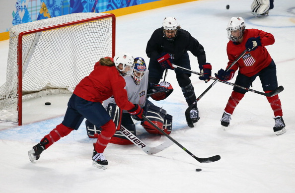 SOCHI, RUSSIA - FEBRUARY 03:  Brianne McLaughlin of the United States women's ice hockey team attempts to make a save during a training session ahead of the Sochi 2014 Winter Olympics at Shayba Arena on February 3, 2014 in Sochi, Russia.  (Photo by Martin Rose/Getty Images)