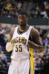 Feb 3, 2014; Indianapolis, IN, USA; Indiana Pacers center Roy Hibbert (55) puts his hands inside his jersey during a game against the Orlando Magic at Bankers Life Fieldhouse. Indiana defeats Orlando 98-79. Mandatory Credit: Brian Spurlock-USA TODAY Sports