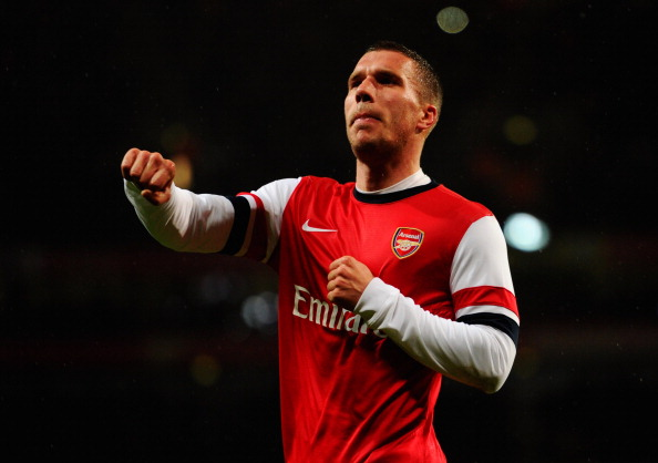 LONDON, ENGLAND - JANUARY 24:  Lukas Podolski of Arsenal celebrates as he scores their second goal with a header during the FA Cup with Budweiser Fourth round match between Arsenal and Coventry City at Emirates Stadium on January 24, 2014 in London, England.  (Photo by Mike Hewitt/Getty Images)