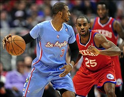 February 9, 2014; Los Angeles, CA, USA; Los Angeles Clippers point guard Chris Paul (3) moves the ball against the Philadelphia 76ers during the first half at Staples Center. Mandatory Credit: Gary A. Vasquez-USA TODAY Sports