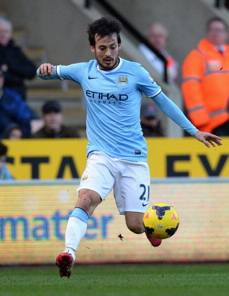 NORWICH, ENGLAND - FEBRUARY 08:  David Silva of Manchester City  during the Barclays Premier League match between Norwich City and Manchester City  at Carrow Road on February 8, 2014 in Norwich, England.  (Photo by Tony Marshall/Getty Images)