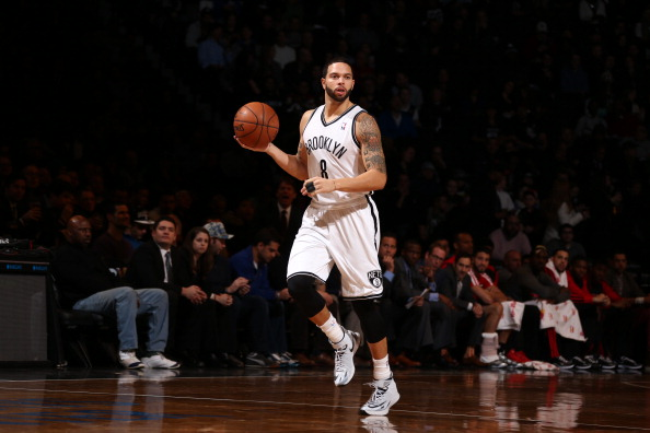 BROOKLYN, NY - JANUARY 27: Deron Williams #8 of the Brooklyn Nets brings the ball up court against the Toronto Raptors during a game at Barclays Center in Brooklyn. NOTE TO USER: User expressly acknowledges and agrees that, by downloading and or using this photograph, User is consenting to the terms and conditions of the Getty Images License Agreement. Mandatory Copyright Notice: Copyright 2014 NBAE (Photo by Nathaniel S. Butler/NBAE via Getty Images)