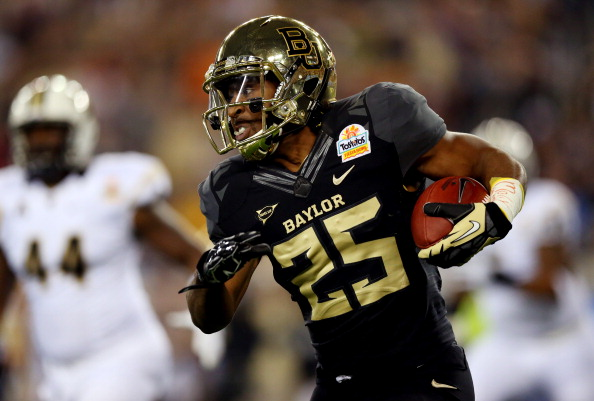 GLENDALE, AZ - JANUARY 01:  Running back Lache Seastrunk #25 of the Baylor Bears carries the ball against the UCF Knights in the first quarter of the Tostitos Fiesta Bowl at University of Phoenix Stadium on January 1, 2014 in Glendale, Arizona.  (Photo by Ronald Martinez/Getty Images)