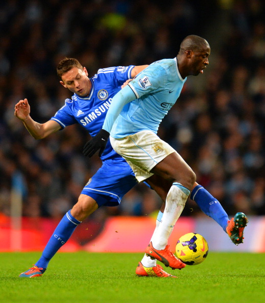 MANCHESTER, ENGLAND - FEBRUARY 03:  Nemanja Matic of Chelsea tackles Yaya Toure of Manchester City during the Barclays Premier League match between Manchester City and Chelsea at Etihad Stadium on February 3, 2014 in Manchester, England.  (Photo by Shaun Botterill/Getty Images)