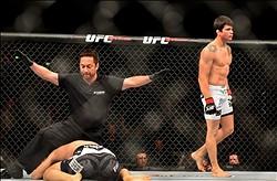Feb 15, 2014; Jaragua do Sul, SC, Brazil; Erick Silva (red gloves) after defeating Takenori Sato (blue gloves) during UFC Fight Night Machida vs Mousasi at Arena Jaragua. Mandatory Credit: Jason Silva-USA TODAY Sports