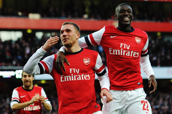 LONDON, ENGLAND - FEBRUARY 16:  Lukas Podolski (L) of Arsenal celebrates with team mate Yaya Sanogo after scoring during the FA Cup Fifth Round match between Arsenal and Liverpool at the Emirates Stadium on February 16, 2014 in London, England.  (Photo by Shaun Botterill/Getty Images)