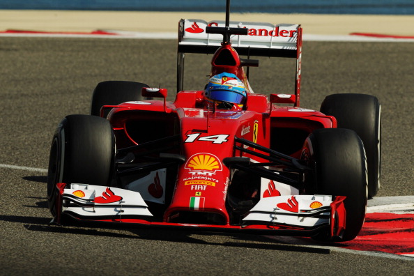 BAHRAIN, BAHRAIN - FEBRUARY 20:  Fernando Alonso of Spain and Ferrari drives during day two of Formula One Winter Testing at the Bahrain International Circuit on February 20, 2014 in Bahrain, Bahrain.  (Photo by Ker Robertson/Getty Images)