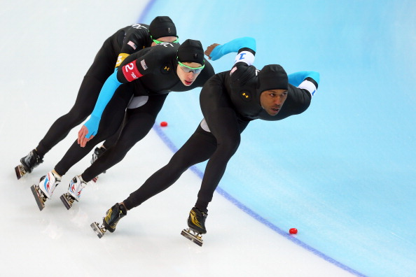 SOCHI, RUSSIA - FEBRUARY 21:  (L to R) Jonathan Kuck, Brian Hansen and Shani Davis of the United States compete during the Men's Team Pursuit Quarterfinals Speed Skating event on day fourteen of the Sochi 2014 Winter Olympics at Adler Arena Skating Center on February 21, 2014 in Sochi, Russia.  (Photo by Quinn Rooney/Getty Images)