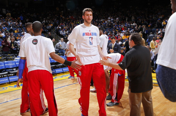 OAKLAND, CA - FEBRUARY 10: Spencer Hawes #00 of the Philadelphia 76ers gets introduced into the starting lineup against the Golden State Warriors on February 10, 2014 at Oracle Arena in Oakland, California. NOTE TO USER: User expressly acknowledges and agrees that, by downloading and or using this photograph, user is consenting to the terms and conditions of Getty Images License Agreement. Mandatory Copyright Notice: Copyright 2014 NBAE (Photo by Rocky Widner/NBAE via Getty Images)