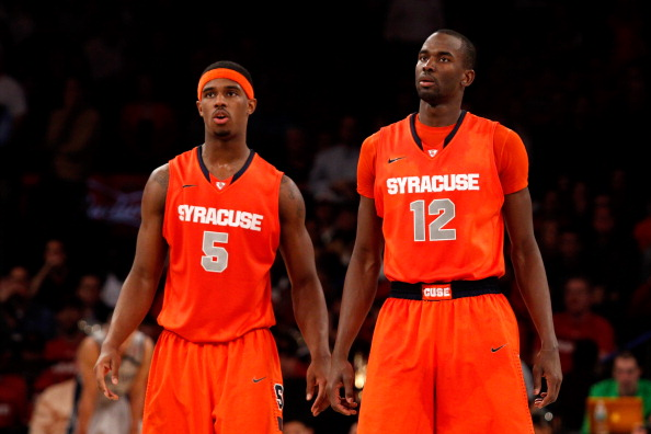 NEW YORK, NY - MARCH 15:  (L-R) C.J. Fair #5 and Baye Keita #12 of the Syracuse Orange look on against the Georgetown Hoyas during the semifinals of the Big East Men's Basketball Tournament at Madison Square Garden on March 15, 2013 in New York City.  (Photo by Chris Chambers/Getty Images)