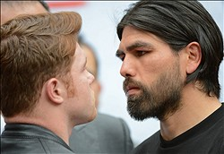 Jan 21, 2014; Los Angeles, CA, USA; Canelo Alvarez and Alfredo Angulo (right) face off during a press conference held at the Los Angeles Central Public Library to announce the 12-round super welterweight bout on March 8, 2014 at the MGM Grand, Las Vegas. Mandatory Credit: Jayne Kamin-Oncea-USA TODAY Sports