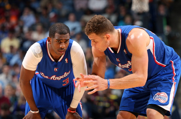 MEMPHIS, TN - FEBRUARY 21: Blake Griffin #32 and Chris Paul #3 of the Los Angeles Clippers talk during a game against the Memphis Grizzlies on February 21, 2014 at FedExForum in Memphis, Tennessee. NOTE TO USER: User expressly acknowledges and agrees that, by downloading and or using this photograph, User is consenting to the terms and conditions of the Getty Images License Agreement. Mandatory Copyright Notice: Copyright 2014 NBAE (Photo by Joe Murphy/NBAE via Getty Images)