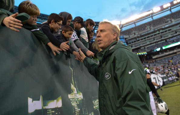 EAST RUTHERFORD, NJ - DECEMBER 22:  General Manager John Idzik shakes hands with fans at the end of the game against the Cleveland Browns at MetLife Stadium on December 22, 2013 in East Rutherford, New Jersey. (Photo by Ron Antonelli/Getty Images)