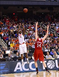 Mar 14, 2014; Greensboro, NC, USA;  Syracuse Orange forward C.J. Fair (5) shoots a three pointer to try and tie the game in the last minute of the second half as North Carolina State Wolfpack center Jordan Vandenberg (14) defends. The Wolfpack defeated the Orange 66-63 in the quarterfinals of the ACC college basketball tournament at Greensboro Coliseum. Mandatory Credit: Bob Donnan-USA TODAY Sports