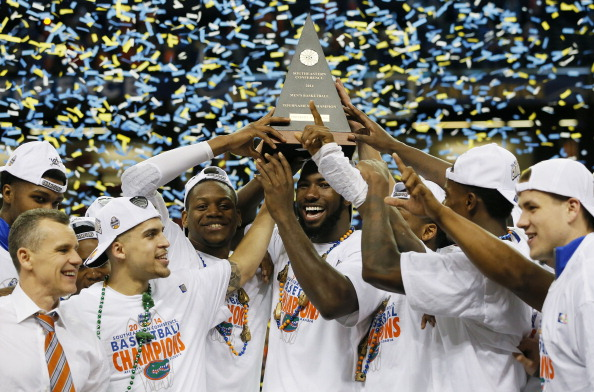 ATLANTA, GA - MARCH 16:  The Florida Gators celebrate with the trophy after their 61 to 60 win over the Kentucky Wildcats in the Championship game of the 2014 Men's SEC Basketball Tournament at Georgia Dome on March 16, 2014 in Atlanta, Georgia.  (Photo by Kevin C. Cox/Getty Images)