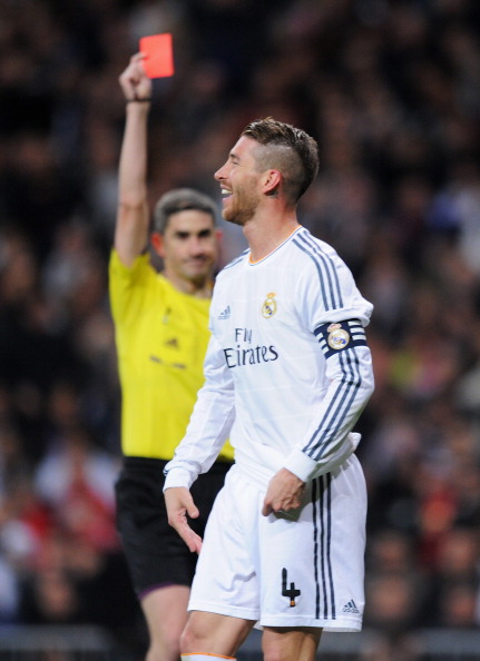 MADRID, SPAIN - MARCH 23: Sergio Ramos of Real Madrid is shown the red card by referee Alberto Undiano Mallenco during the La Liga match between Real Madrid CF and FC Barcelona at the Bernabeu on March 23, 2014 in Madrid, Spain.  (Photo by Denis Doyle/Getty Images)