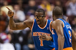 Mar 21, 2014; Philadelphia, PA, USA; New York Knicks forward Amar'e Stoudemire (1) celebrates with  during the first quarter against the Philadelphia 76ers at the Wells Fargo Center. Mandatory Credit: Howard Smith-USA TODAY Sports